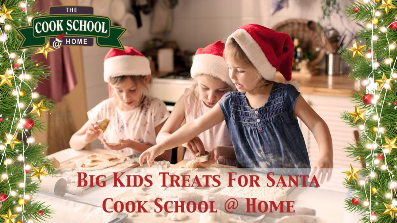 Kids baking cookies with Santa hats on.